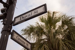 Duval Street and Greene street signs on light pole.